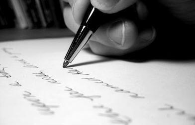mão a escrever